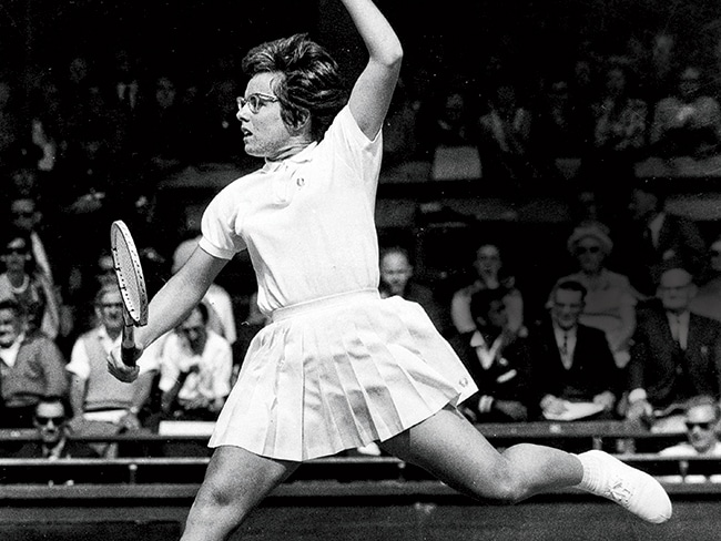 Billie Jean King in action in 1965 at Wimbledon, where she won the doubles title that year. She would win the singles title for the first time the following year—and against her doubles partner, Brazilian Maria Bueno, no less.