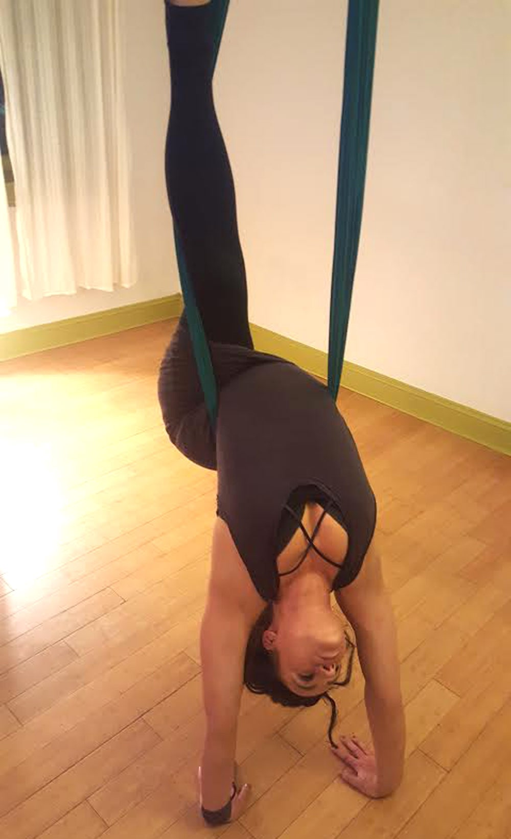 Carrie Ann, co-owner and studio director of kaya aerial yoga