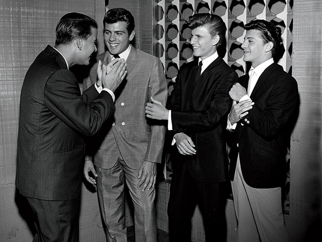 Dick Clark (left) hosts South Philadelphia performers (from left) Fabian, Bobby Rydell, and Frankie Avalon on American Bandstand, the most popular dance show of all time, and where each of these teen idols got their start.