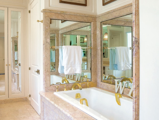 Regal gold fixtures abound in the master bathroom.