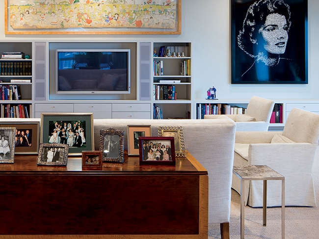 Designed by Betsy McCue Train, the décor in Marjorie Weingarten's home (including the living room, pictured) juxtaposes modern art with classic furniture and family mementos.