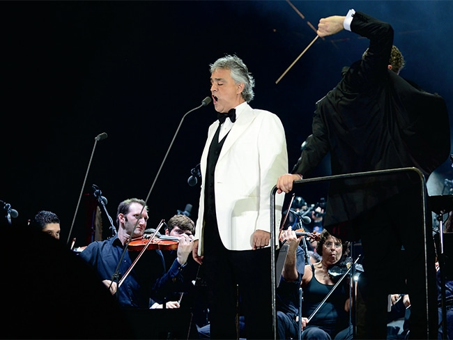 Andrea Bocelli will delight the millions gathered at the foot of the Art Museum when he headlines the Festival of Families on September 26. He is seen here with conductor Eugene Kohn performing during the Miami Beach 100 Centennial Concert in March.